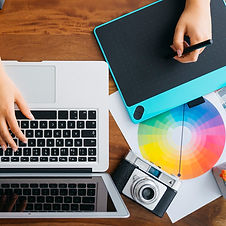 top-view-graphic-designer-working-with-graphic-tablet-laptop_edited.jpg