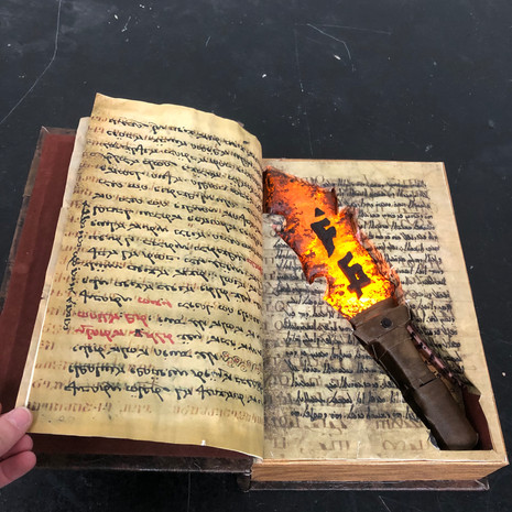 Red-Hot Stone Ritual Knife in Archaic Bible