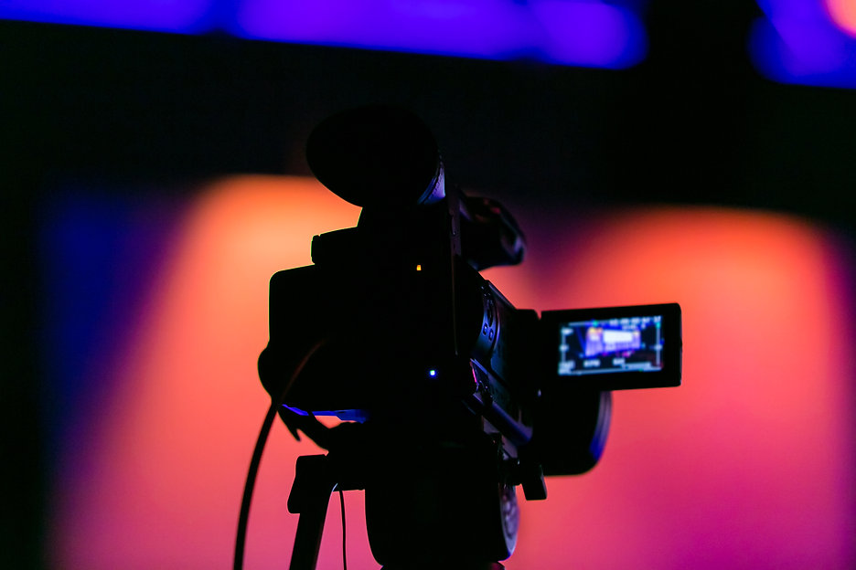 Silhouette of a video camera capturing a