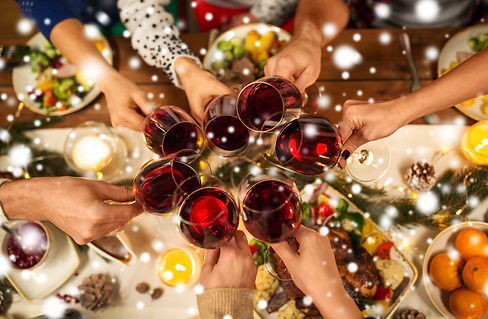 holidays and celebration concept - close up of friends having christmas dinner at home, dr...now.jpg