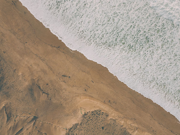 brown sand near body of water during daytime_edited.jpg