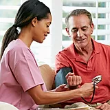 Nurse with older man.webp