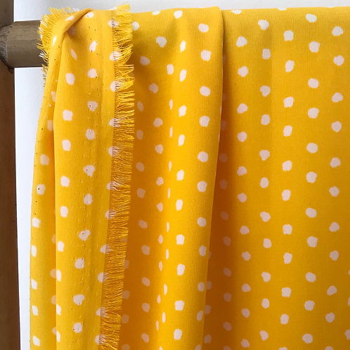 Tissu fond jaune à pois blanc