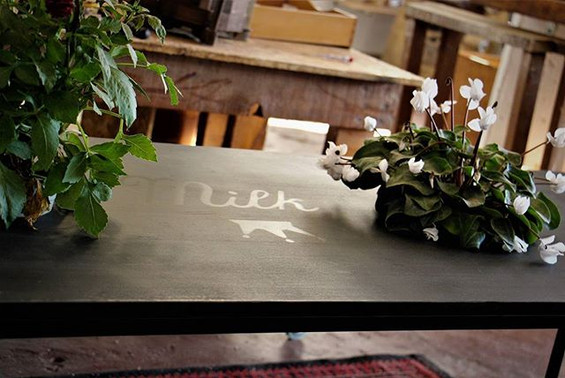 A new metal and wood cummunal table and