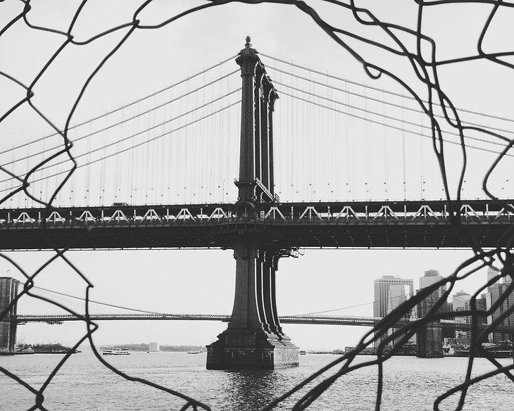 suspension-bridge-behind-chainlink-fence-G9SCCMC_edited.jpg