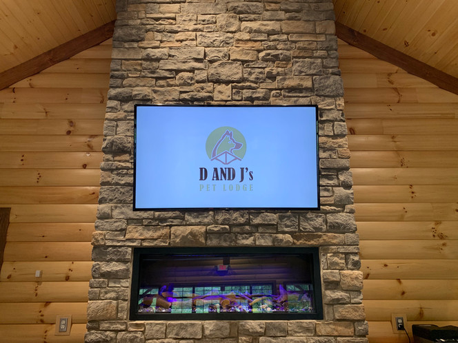 Welcoming Fireplace and Informational TV