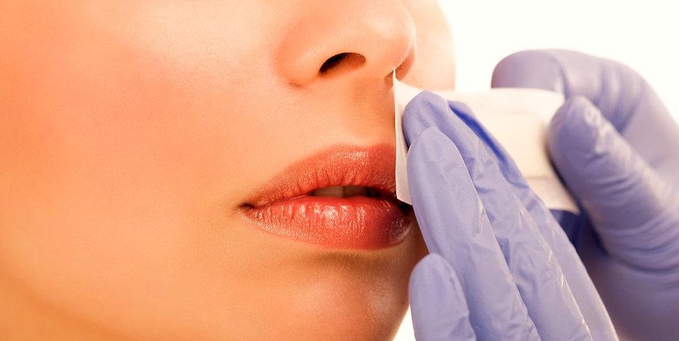 woman-reciving-facial-epilation-royalty-free-image-480136411-1556647804_edited.jpg