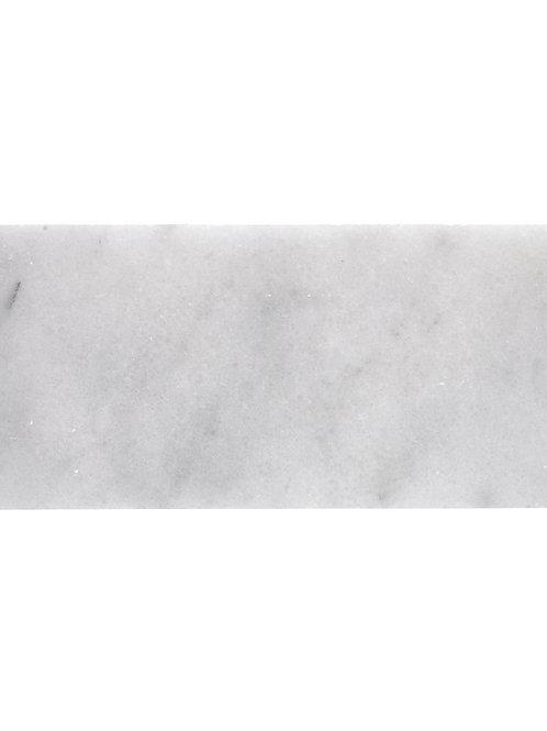Herringbone honed marble tile