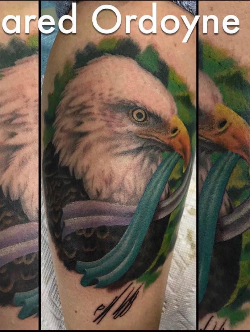 Eagle holding Ribbon