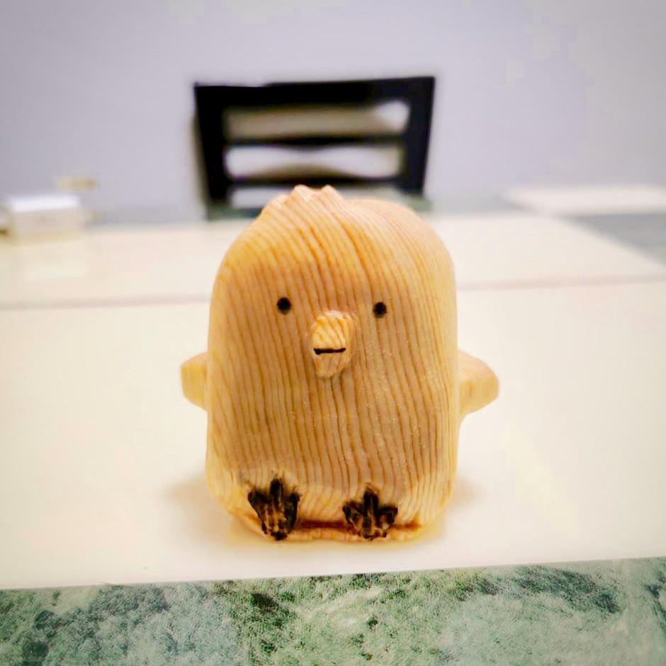 chick wood sculpture