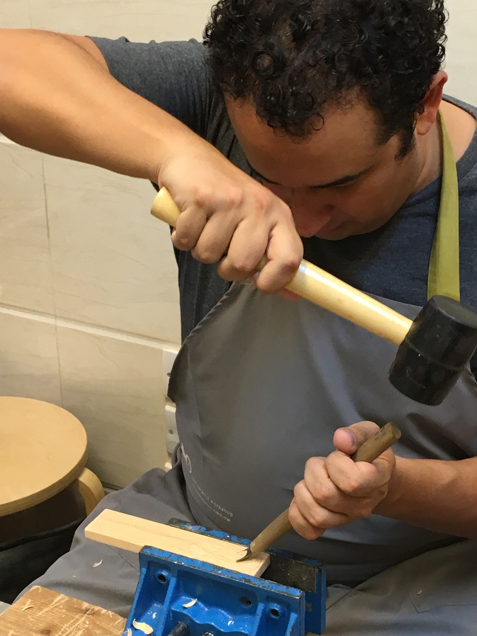 They carving wood spoon