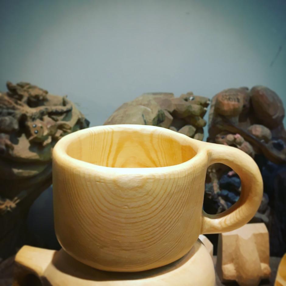 She handmade wood cup