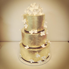 Gold Leaf and White Flowers Wedding Cake