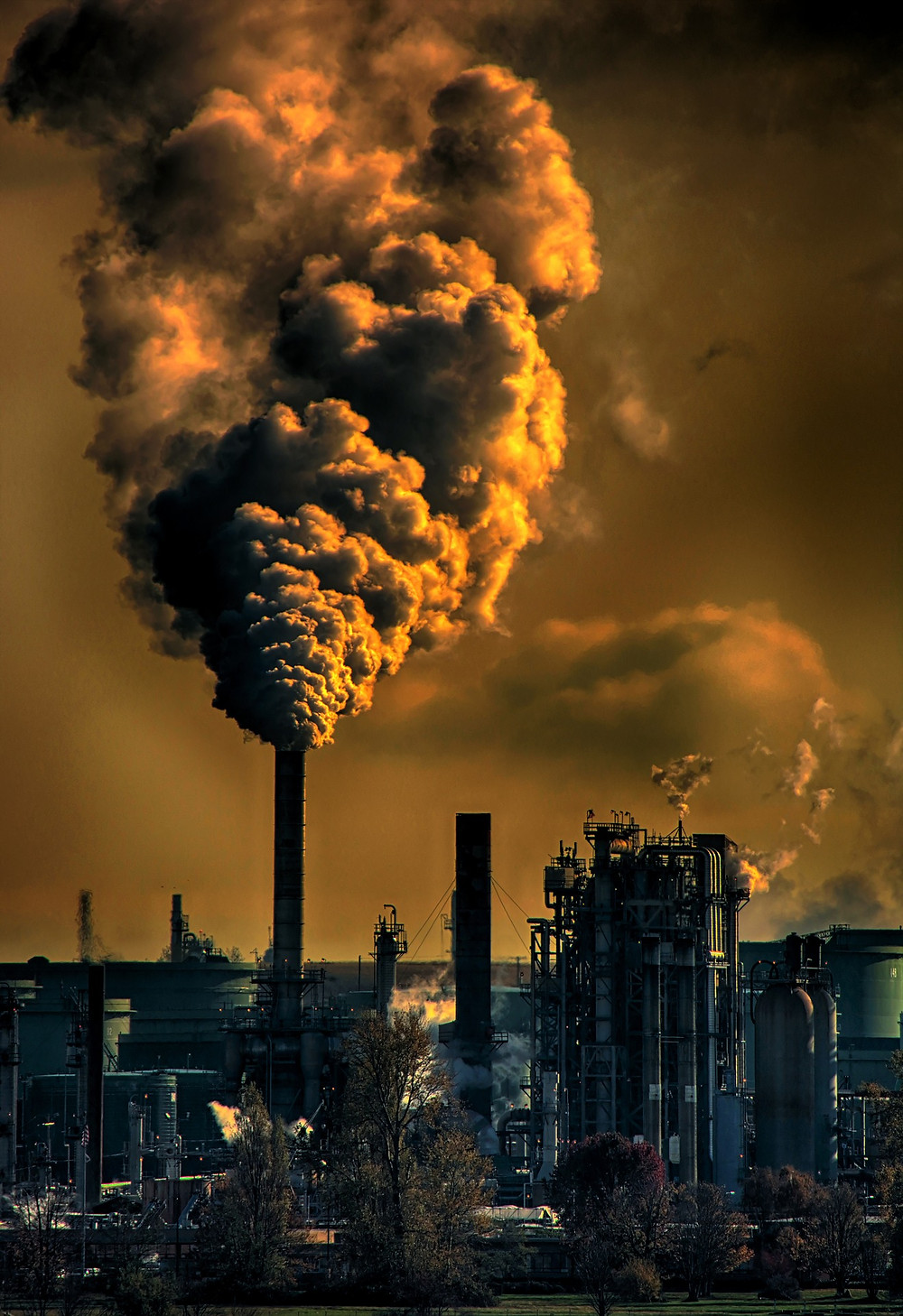 Shows factories releasing pollutants into the air. Air pollution exacerbates skin ageing and causes the development of skin problems like acne.
