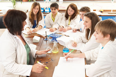 Group Of Teenage Students In Science Cla