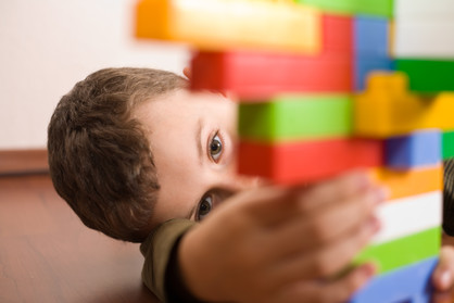 Canva - Cute kid playing with cubes (1).