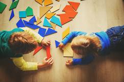 Canva - kids playing with puzzle, educat