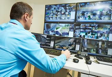 security%20guard%20watching%20video%20mo
