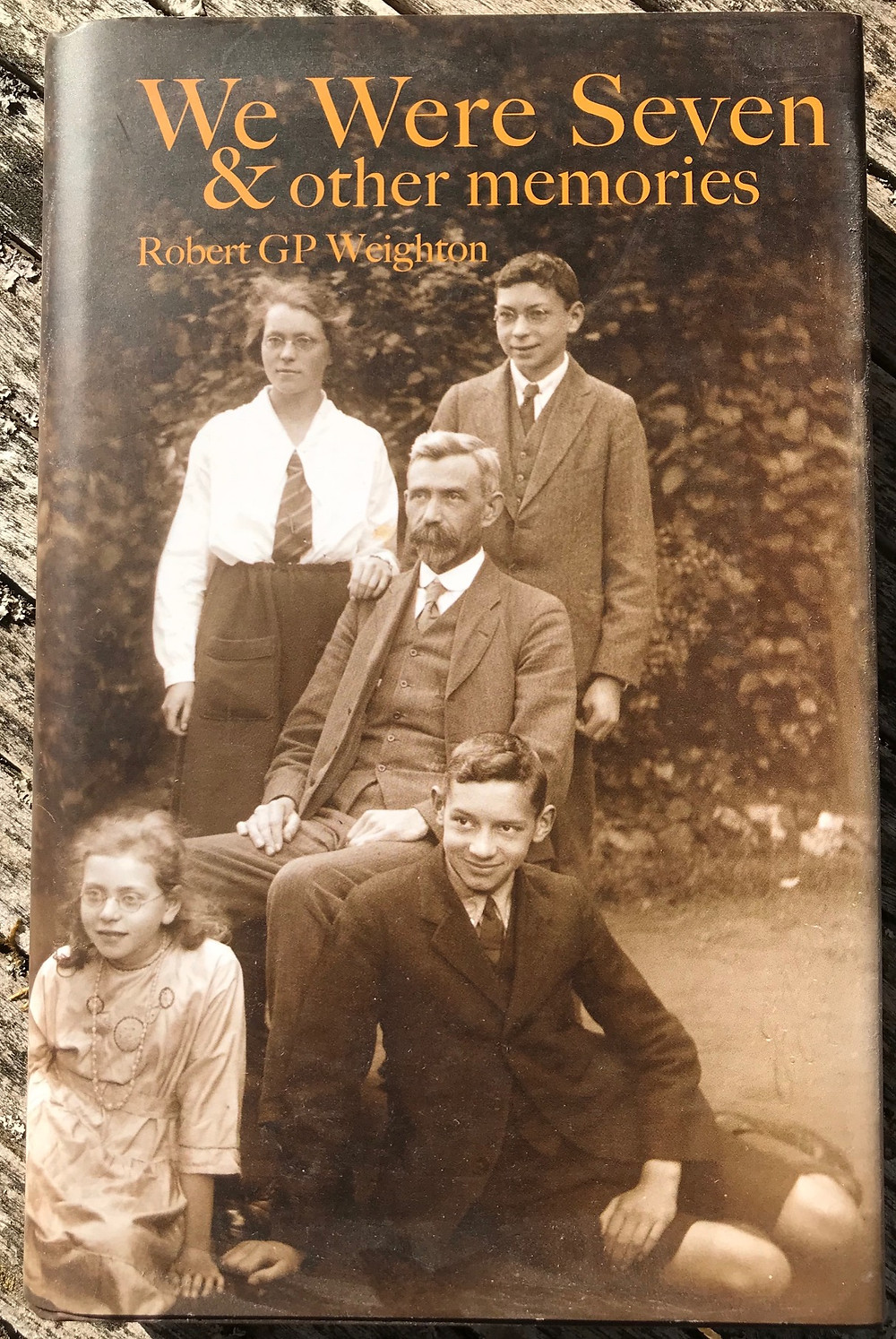 Bob is pictured with his family on the top right of the book cover of his memoirs