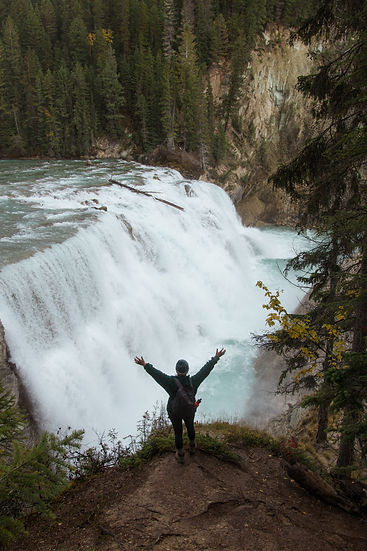 Traveller Overlooking Rushing Waters of Wapta Falls in YOHO National Park