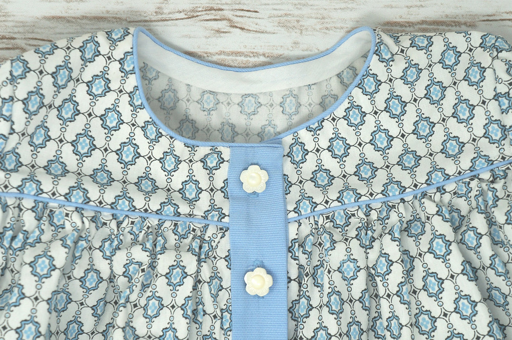 Close-up of top showing piped collar and closure