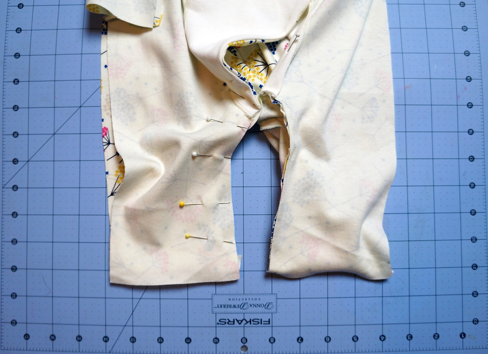 I sewed the crotch seam overlap in the sewing machine and only after making sure I was pleased with the result did I serge the seam.
