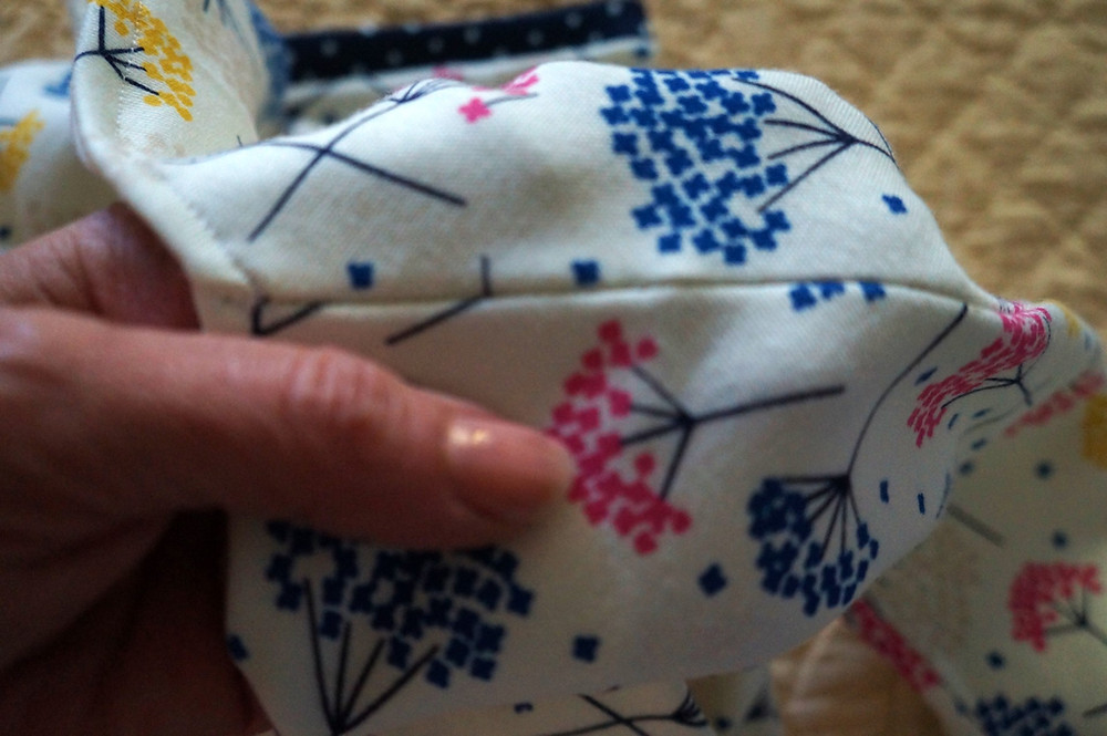 Stitching in the ditch of the should seam to keep the lining in place.
