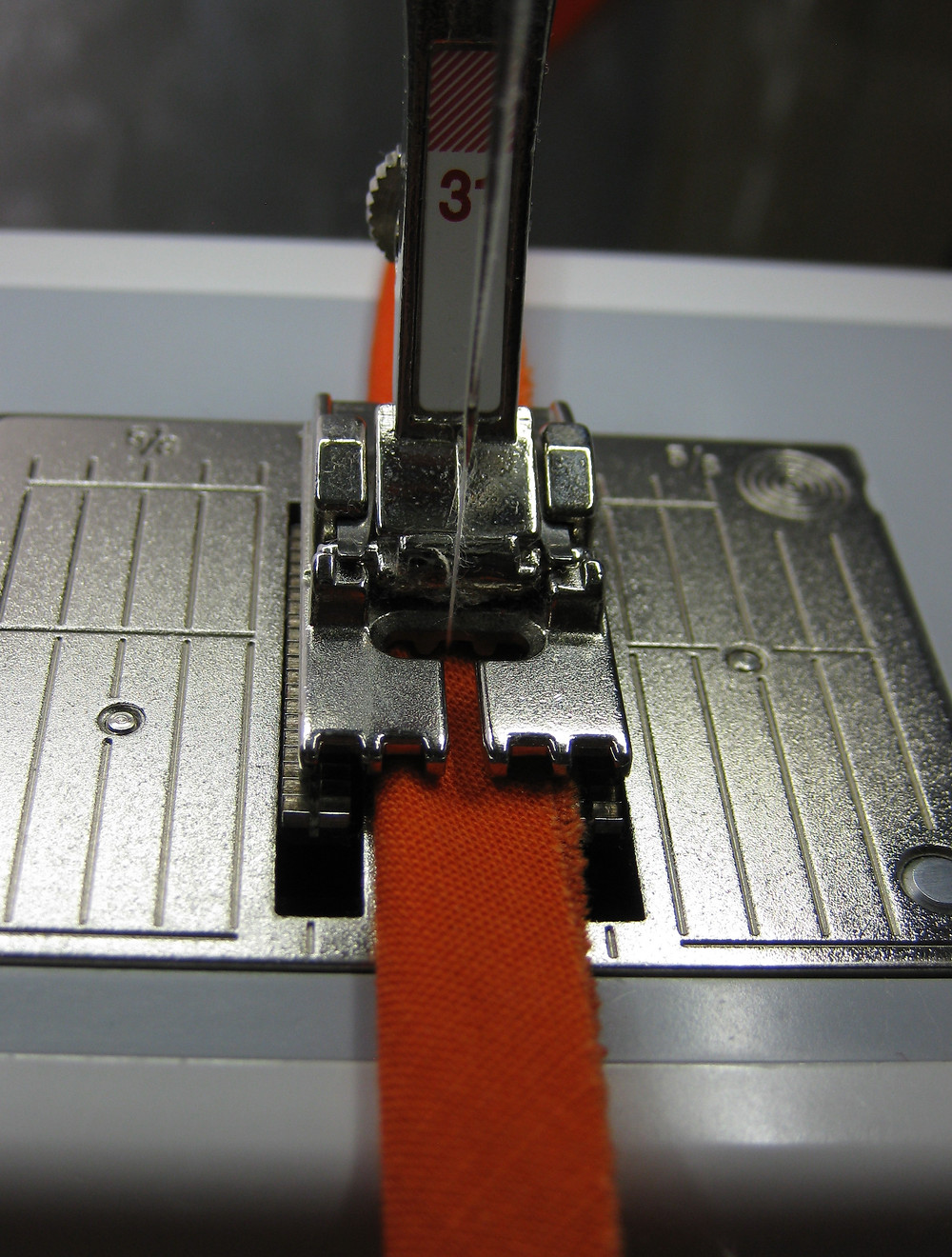 Stitching the piping cord with the 5 groove pintuck foot.