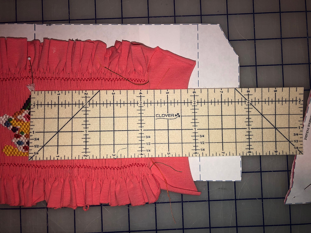Measure from insert center to edge of smocking.