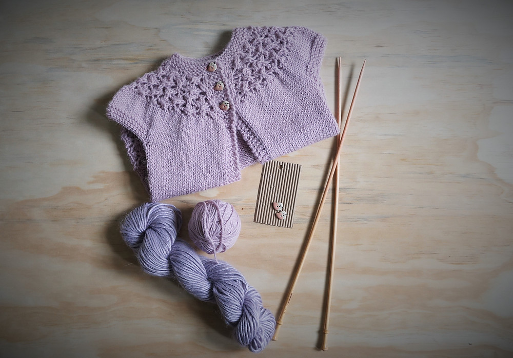 Flat Lay of In Threes Sweater with lace