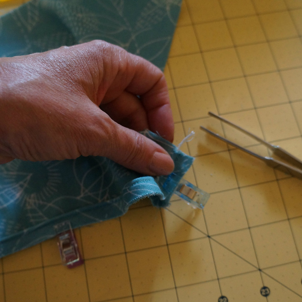 Remove the cording from the seam allowance
