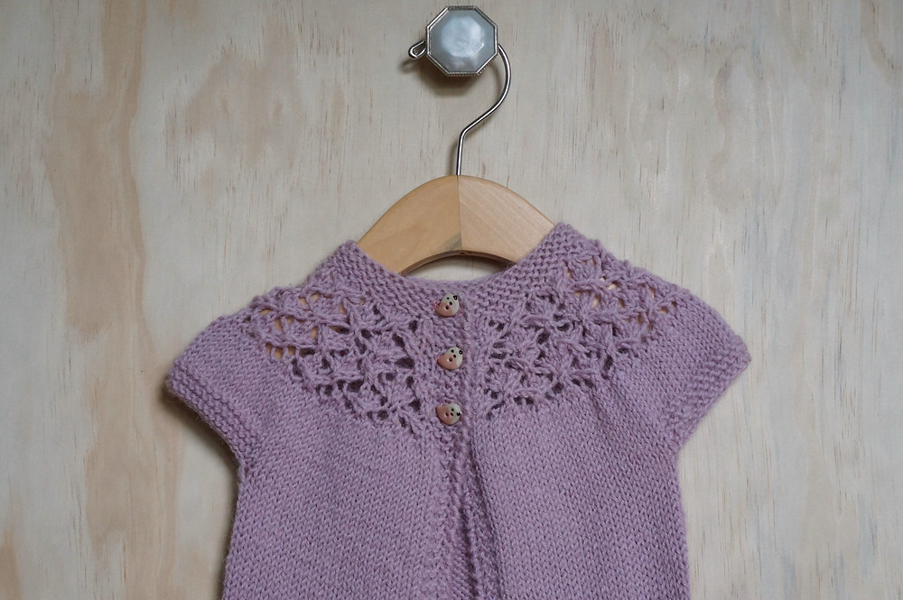 Close up of In Threes Sweater with Lace and Bird Buttons