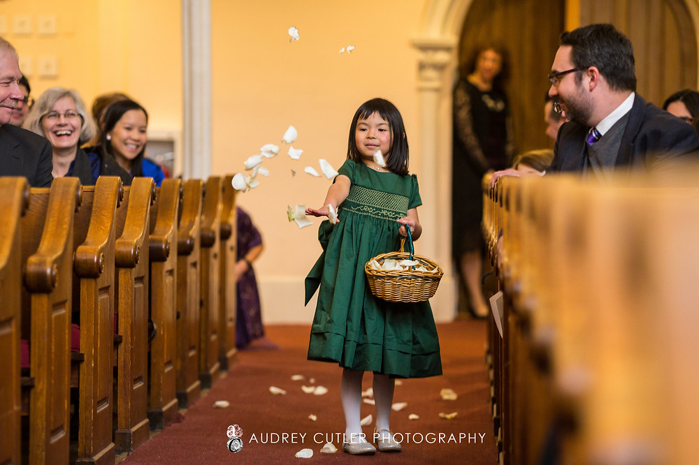 Flower girl throwing her petals!