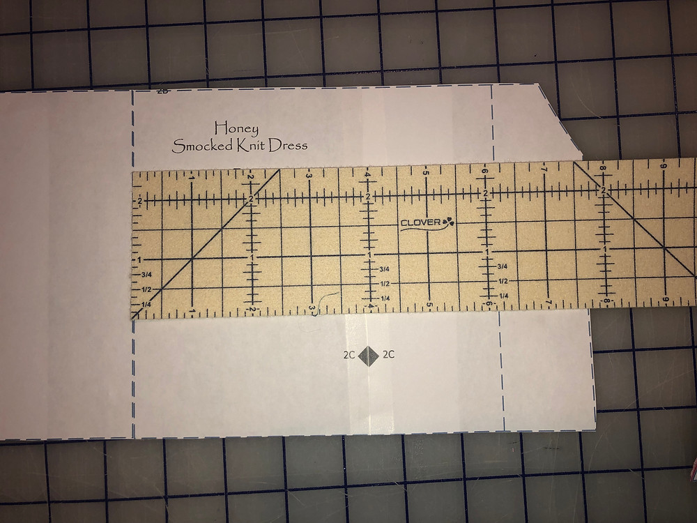 Measure from blocking guide center front to side seam.