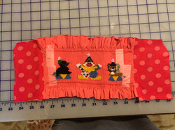 Adding side panels to a smocked inse