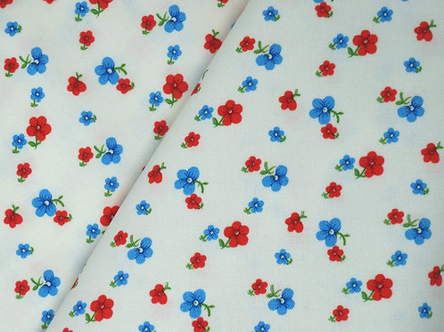 Red and blue pansy fabric on a white background