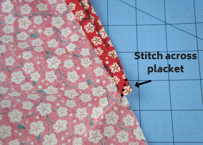 Stitching across the placket