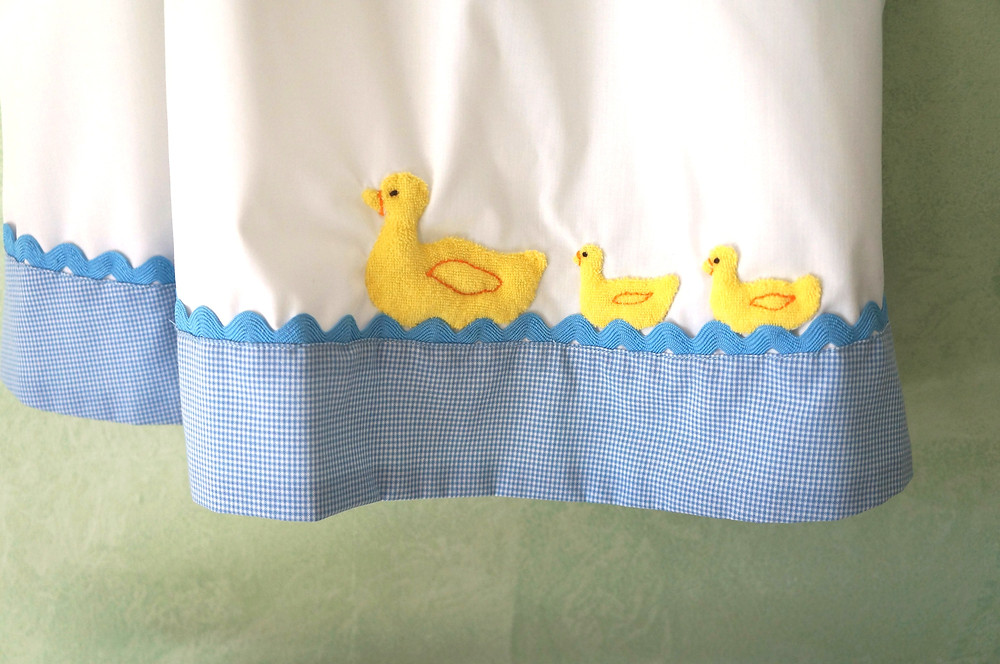 Mother and Baby Ducks on Hem of Dress