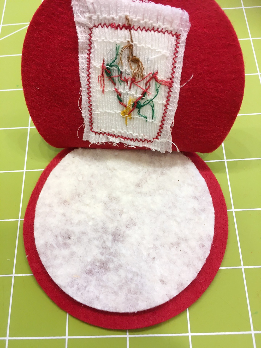 The ornament with the batting inserted.