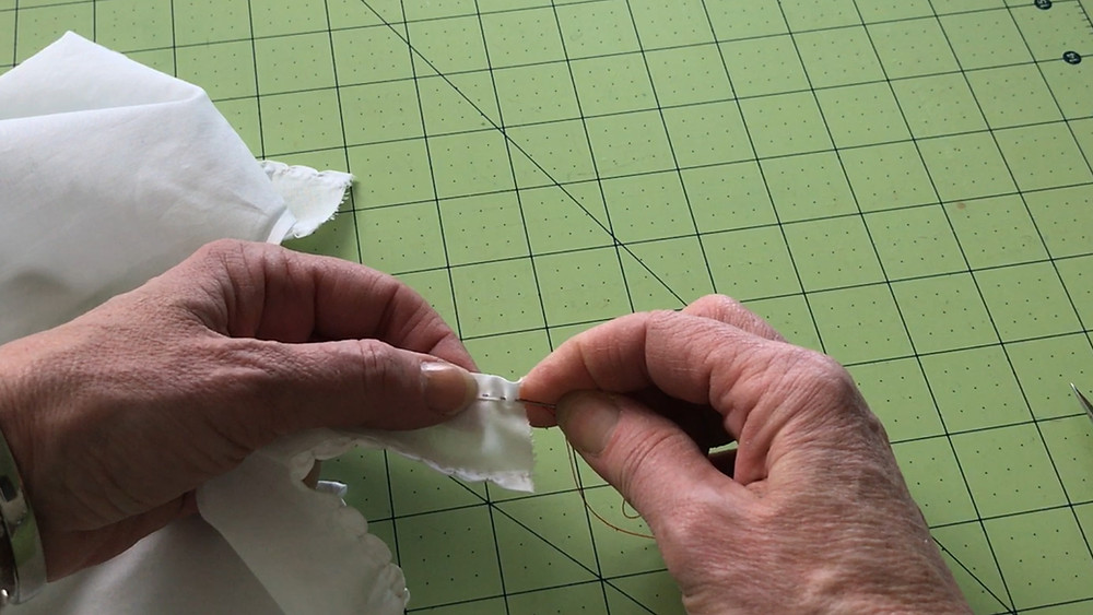 Make running stitches along the hem edge