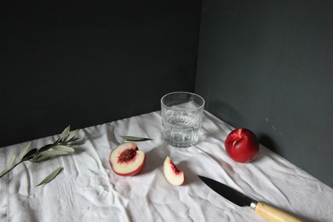 Food styling, peach and knife surrealist deutsh inspired