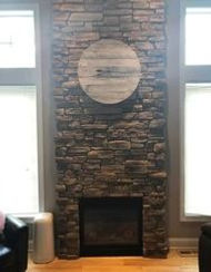Dry stacked stone fireplace project in new home