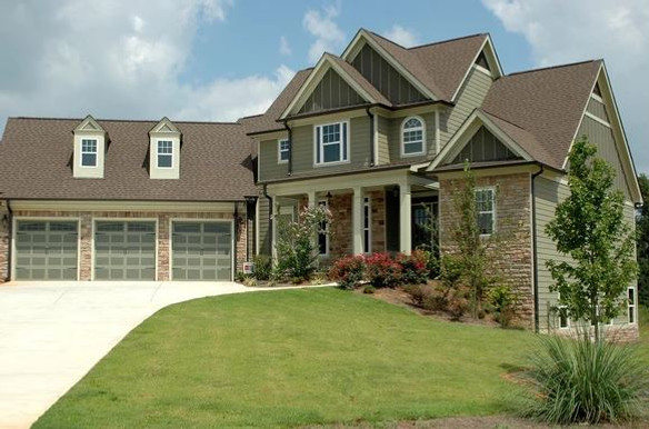 New home with exterior ledgestone accent walls
