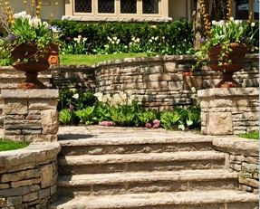 Natural stacked stone retaining walls landscape enclosure with steps