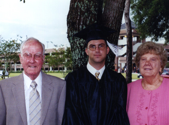 Chris graduating from UCF with his grandparents.