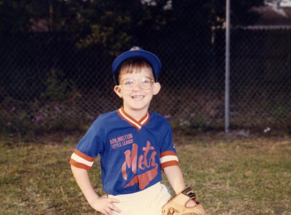 Chris playing baseball as a kid.