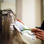 Hairdresser is dying female hair, making