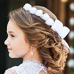 Portrait of cute little girl on white dr