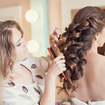 Beautiful bride applying wedding make-up