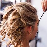 Blonde wavy girl sitting at  hairstyling